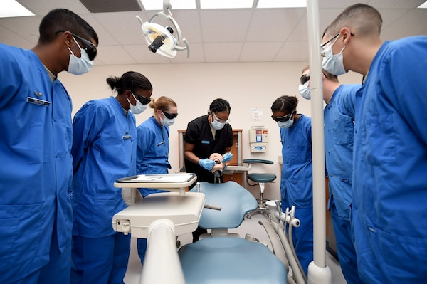 Tech. Sgt. Christy Nixon, Instructor supervisor of the Air Force Dental Assistant Training program, gives students a glimpse of the restorative materials they will work with during training Oct. 20, 2016 at the Medical Education and Training Campus on Joint Base San Antonio-Fort Sam Houston. The dental assistant apprentice course is one of four courses taught at the 381st Training Squadron, a unit of the 59th Training Group. (U.S. Air Force photo/Staff Sgt. Jerilyn Quintanilla)