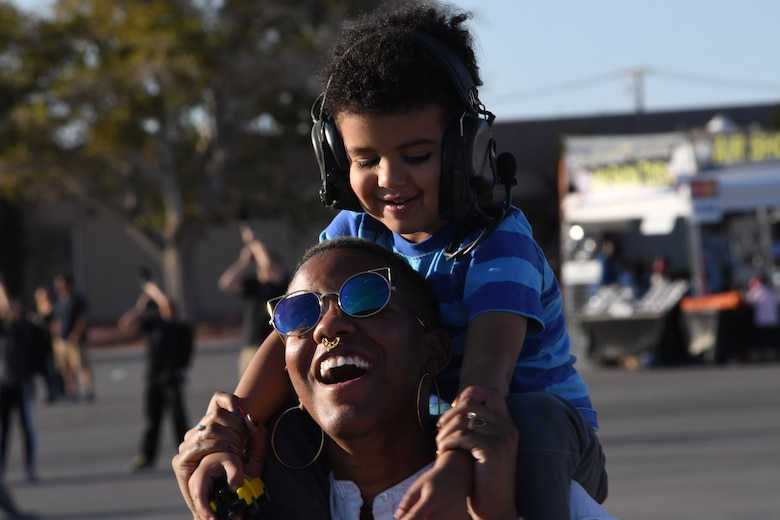 A mother and her child enjoy an aircraft demonstration during Aviation Nation Nov. 11, 2016, at Nellis Air Force Base, Nevada. More than 300,000 visitors attended the air show. (U.S. Air Force photo by Senior Airman Christian Clausen/Released)