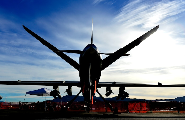 An MQ-9 Reaper sits on display during Aviation Nation Nov. 12, 2016, at Nellis Air Force Base, Nevada. An MQ-9 Reaper and MQ-1 Predator were displayed at the air show. The MQ-1 and MQ-9 are both medium-altitude, long-endurance remotely piloted aircraft capable of supporting persistent attack and reconnaissance in support of global contingency operations. (U.S. Air Force photo by Senior Airman Christian Clausen/Released)
