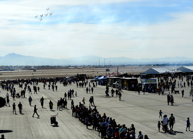 Spectators enjoy an aerial demonstration during Aviation Nation Nov. 12, 2016, at Nellis Air Force Base, Nevada. The base hosted more than 300,000 people during the air show. (U.S. Air Force photo by Senior Airman Christian Clausen/Released)