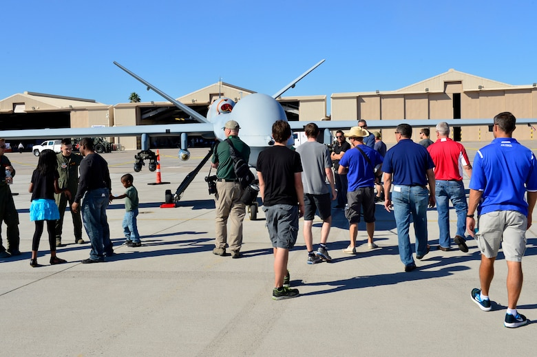 Spectators get a closer look at an MQ-9 Reaper at Aviation Nation Nov. 11, 2016, at Nellis Air Force Base, Nevada. The public was able to get a close view of the aircraft while also being educated on its capabilities from members of Creech Air Force Base, Nevada. (U.S. Air Force photo by Senior Airman Christian Clausen/Released)