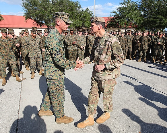 U.S. Army General Joseph L. Votel, commander of U.S. Central Command met with Lieutenant General William D. Beydler, Commander U.S. Marine Corps Forces, Central Command, at MacDill Airforce Base on November 8. General Votel visited the MARCENT Headquarters for a staff brief and tour of the facility. Additionally he recognized six MARCENT Marines for superior performance in their duties and provided them each one of his 4-star challenge coins.