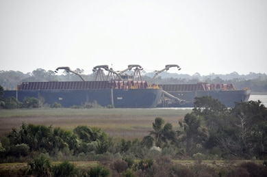 A spider barge and two scow vessels sit idle in the Savannah River's South Channel near Fort Pulaski, Nov. 1, while the Dredge Illinois works on the other side of Cockspur Island.
