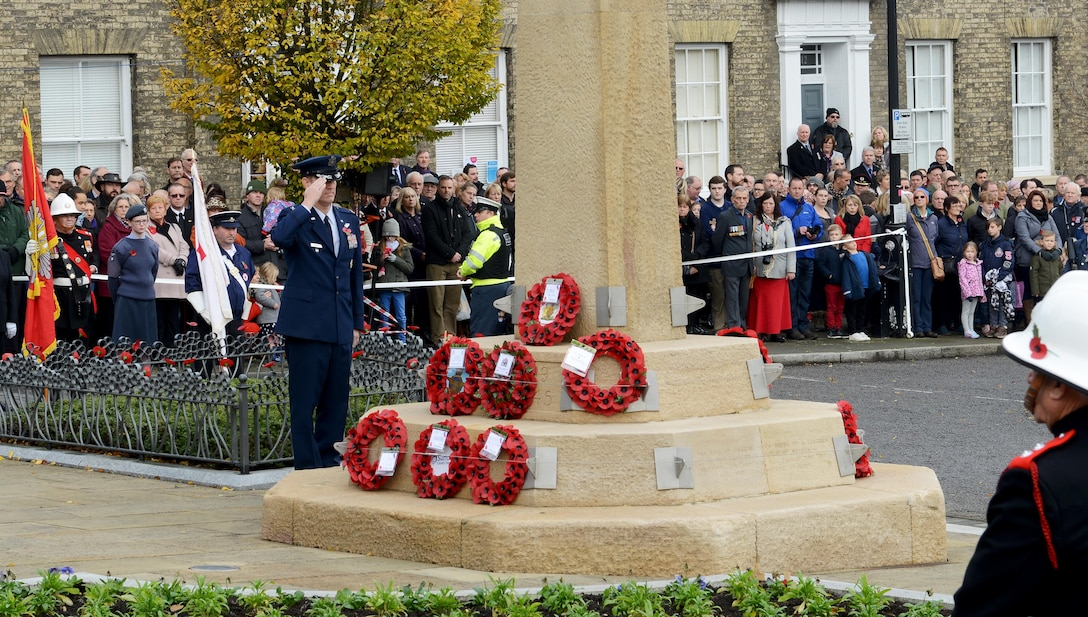 U.S. Air Force Col. John Howard, 100th Air Refueling Wing vice commander, salutes the memorial on Angel Hill during a wreath-laying ceremony Nov. 13, 2016, in Bury St. Edmunds, England. Remembrance Sunday was originally named Armistice Day after World War I, which ended at the 11th hour on the 11th day of the 11th month in 1918. The day was changed to Remembrance Sunday after World War II to honor all of the men and women who died serving their country. (U.S. Air Force photo by Staff Sgt. Richard Ware)