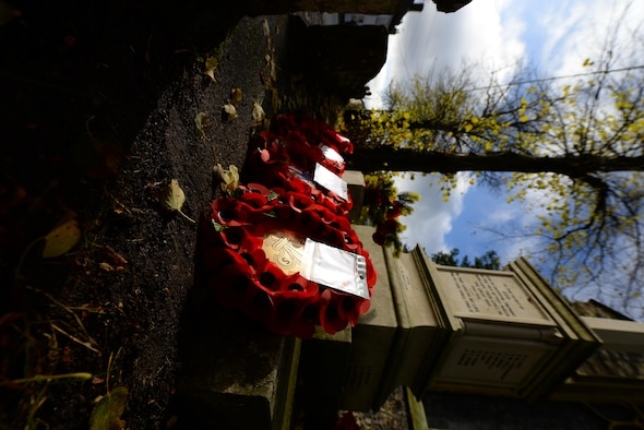 Wreaths lay at the base of a memorial after a Remembrance Sunday ceremony Nov. 13, 2016, in Dickleburgh, England. The poppy was chosen as the symbol of remembrance because many British soldiers lost their lives in the poppy fields of Flanders, Belgium, during World War I. (U.S. Air Force photo by Staff Sgt. Micaiah Anthony)
