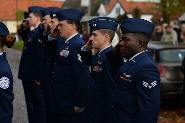 U.S. Air Force Airmen from RAF Mildenhall, England, salute during a remembrance ceremony Nov. 13, 2016, in Dickleburgh, England. Remembrance Sunday was originally named Armistice Day after World War I, which ended at the 11th hour on the 11th day of the 11th month in 1918. The day was changed to Remembrance Sunday after World War II to honor all of the men and women who died serving their country. (U.S. Air Force photo Staff Sgt. Micaiah Anthony)