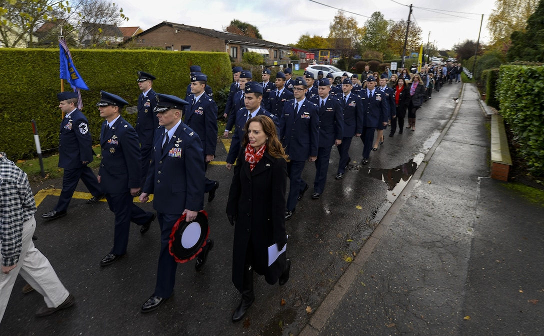 U.S. Air Force Airmen from RAF Mildenhall, England, march down a street Nov. 13, 2016, in Dickleburgh, England. The Airmen participated in a parade for Remembrance Sunday, an event held each year to honor service members who gave their lives in defense of their nation. (U.S. Air Force photo by Staff Sgt. Micaiah Anthony)