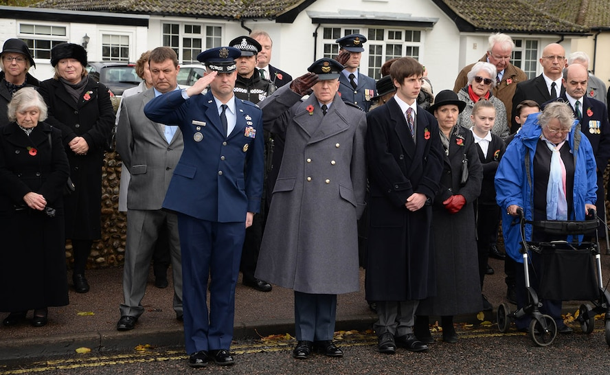 "U.S. Air Force Lt. Col. Ryan White, 100th Maintenance Group deputy commander, left of center, and Sqdn. Ldr. Richard Fryer, center, RAF Mildenhall station commander, salute during the playing of ""The Last Post"" at the Remembrance Sunday parade Nov. 13, 2016, in Mildenhall, England. U.S. Air Force Airmen from RAF Mildenhall took part in the event along with Sea Cadets, Army Cadets, Air Cadets and other groups from the local community. Remembrance ceremonies are held around the U.K. each year on the closest Sunday to Armistice Day, Nov. 11, to honor those who lost their lives in wars both past and present. (U.S. Air Force photo by Karen Abeyasekere)"