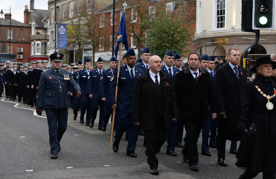 U.S. Air Force Airmen from Team Mildenhall march down the high street during a Remembrance Sunday parade after laying a poppy wreath at the memorial Nov. 13, 2016, in Newmarket, England. Poppies were chosen as a symbol of remembrance because many British soldiers lost their lives in the poppy fields of Flanders, Belgium, during World War I. (U.S. Air Force photo by Karen Abeyasekere)