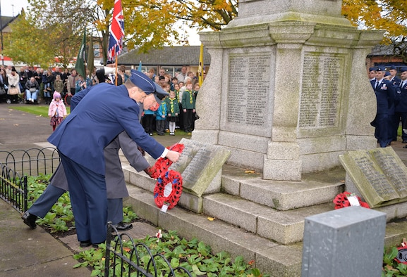 U.S. Air Force Lt. Col. Sean Lewis, front right, 727th Air Mobility Squadron commander, lays a wreath with Sqdn. Ldr. Richard Fryer, front left, RAF Mildenhall station commander, during a Remembrance Sunday ceremony Nov. 13, 2016, in Newmarket, England. Poppies were chosen as a symbol of remembrance because many British soldiers lost their lives in the poppy fields of Flanders, Belgium, during World War I. (U.S. Air Force photo by Karen Abeyasekere)