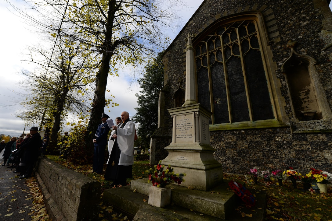 Rev. Norman Steer, British Legion chaplain, gives opening remarks during a Remembrance Sunday ceremony Nov. 13, 2016, in Dickleburgh, England. U.S. Air Force Airmen from RAF Mildenhall, England, participated in ceremonies and services throughout the local area to honor those who died during previous and current conflicts.  (U.S. Air Force photo by Staff Sgt. Micaiah Anthony)