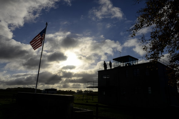 U.S. Air Force Airmen from RAF Mildenhall, England, look out from the air traffic control tower Nov. 13, 2016, at the 100th Bomb Group Memorial Museum in Dickleburgh, England. Airmen visited the museum after participating in a local remembrance ceremony to honor those who have died in previous conflicts. (U.S. Air Force photo by Staff Sgt. Micaiah Anthony)