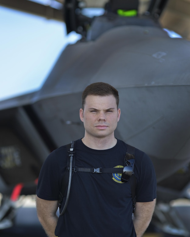 U.S Air Force Senior Airman Samuel Privett, 43rd Aircraft Maintenance Unit weapons load crew member, stands at parade rest in front of an F-22 Raptor at Tyndall Air Force Base, Fla., Nov. 4, 2016. Privett recently led a team of 43rd AMU Airmen to troubleshoot a re-occurring maintenance issue with a Tyndall F-22. Privett ensured accurate communication between multiple work shifts to isolate the issue, and played a key role in developing a cost effective solution. (U.S. Air Force photo by Tech. Sgt. Javier Cruz/Released)
