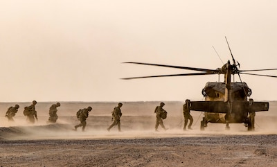 Soldiers with the 77th Armored Regiment, 3rd Brigade, 1st Armored Division, load onto a UH-60 Black Hawk helicopter after completing their iteration of the squad live-fire exercise Nov. 2, 2016 at Udari Range near Camp Buehring, Kuwait. Infantry Soldiers, indirect fire infantrymen and forward observers synchronized their capabilities during thefour-day training event by executing dismounted squad battle drills. (U.S. Army photo by Sgt. Angela Lorden)