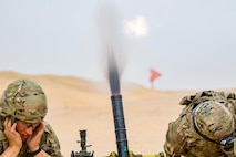 Mortar Soldiers with the 77th Armored Regiment, 3rd Brigade, 1st Armored Division, firea 60mm mortar round to provide indirect, suppressive fire for infantry Soldiers during a squad live-fire exercise Nov. 3, 2016 at Udari Range near Camp Buehring, Kuwait.  Mortar fire was part of the four-day training exercise that synchronized the capabilities of infantry Soldiers, indirect fire infantrymen and forward observers. (U.S. Army photo by Sgt. Angela Lorden)