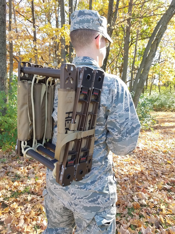 1st Lt. Stuart Baker demonstrates the portability of the JFWORX-developed Roco Atlas Casualty Carrier. This strong and lightweight tactical ladder can also function as bridge between structures and as a stretcher to transport injured personnel. (U.S. Air Force photo/Holly Jordan)
