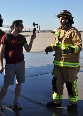 Josh Kelman, an Arizona State University representative, interviews Tech. Sgt. Gabe Ulibarri, 944th Civil Engineer Squadron firefighter, Nov. 6 during an annual egress