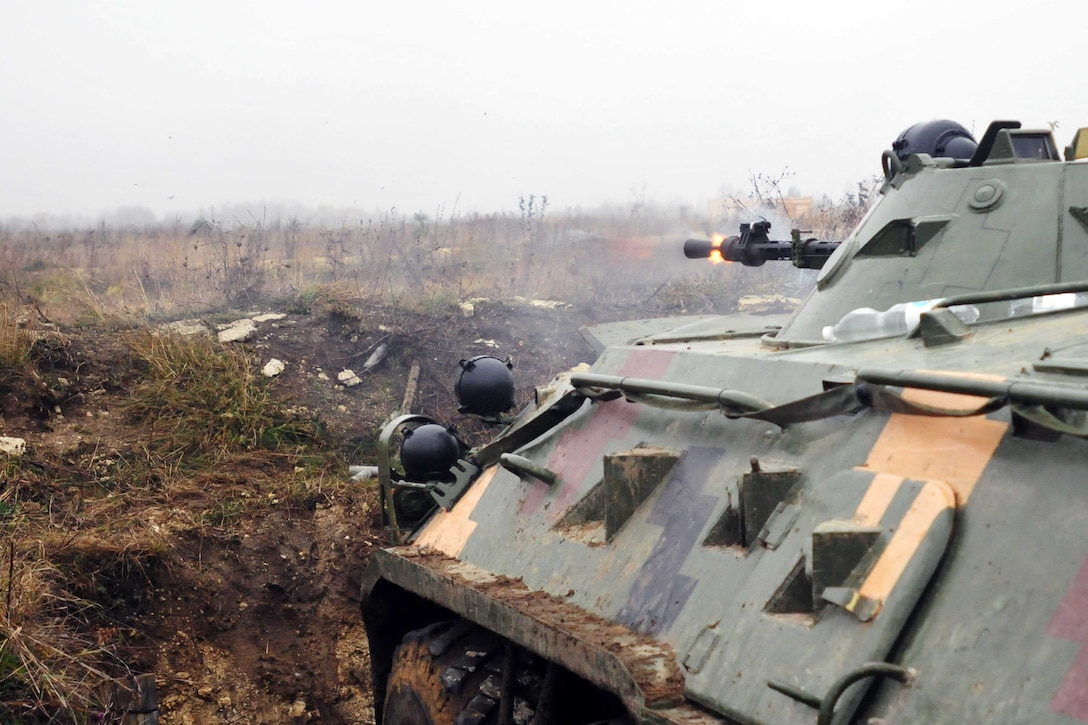 A BTR armored personnel carrier provides suppressing fire during a live-fire training exercise at the International Peacekeeping and Security Center in Yavoriv, Ukraine, Nov. 12, 2016. Army photo by Sgt. Jacob Holmes