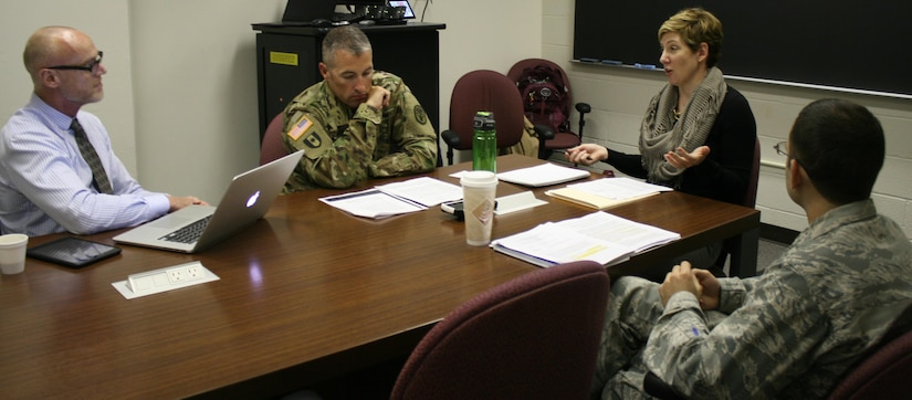 Dr. Alexis Battista, second from right, teaches a seminar at the Uniformed Services University of the Health Sciences in Bethesda, Md. The seminar was part of the university's new Health Professions Education program. DoD photo by Sarah Marshall