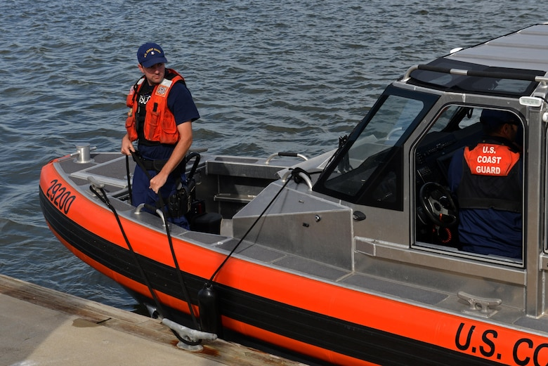 A U.S. Coast Guardsman ties up a 29-foot response boat-small at Coast Guard Station Tybee, Ga., Nov. 8, 2016. Coast Guardsmen assigned to Tybee and Coast Guard Station Savannah, Ga., participated in water survival training with 20th Fighter Wing pilots assigned to Shaw Air Force Base, S.C., simulating aircraft ejections and helicopter rescues. (U.S. Air Force photo by Airman 1st Class Destinee Sweeney)