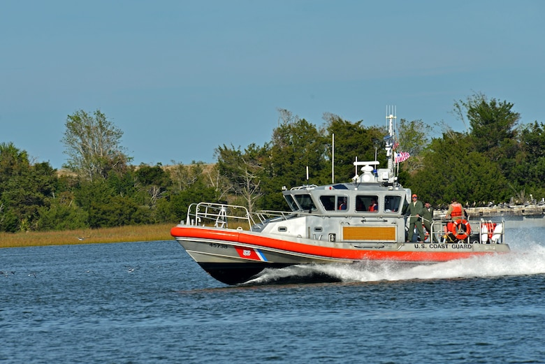 U.S. Airmen and Coast Guardsmen travel toward land on a 45-foot response boat-medium at Coast Guard Station Tybee, Ga., Nov. 8, 2016. In 2013, the Coast Guard saved more than 3,000 people during search and rescue missions. (U.S. Air Force photo by Airman 1st Class Destinee Sweeney)