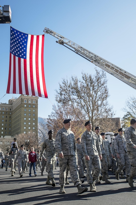 Defenders from 75th Security Forces Squadron walk in the Ogden Veterans Day Parade Nov. 12 in downtown Ogden. (U.S. Air Force photo by Paul Holcomb)