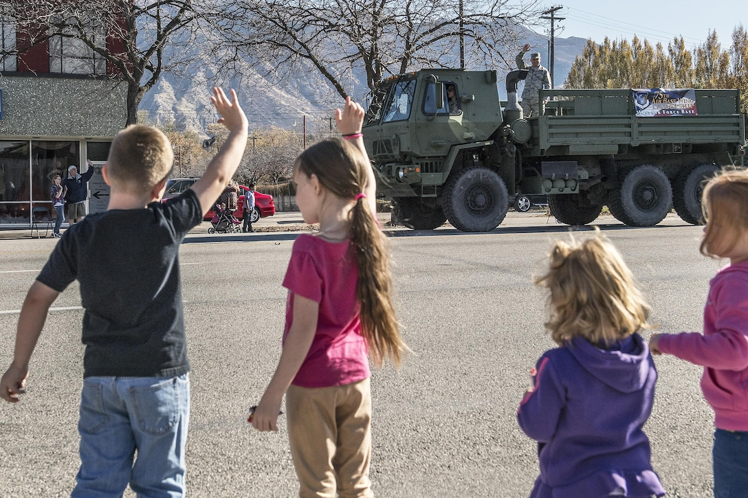 Col. David Dunklee, 75th Air Base Wing vice commander, waives to families lining the streets during the Ogden Veterans Day Parade Nov. 12 in downtown Ogden. (U.S. Air Force photo by Paul Holcomb)