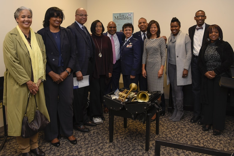 "Terell Stanfford, center left, Jazz Heritage Series iconic jazz artist and Lt. Gen. Stayce Harris, center right, Air Force assistant vice chief of staff, and her accompanied guests pose for a group photo in Alexandria, Va., Nov. 11, 2016. Harris met and greeted the jazz artist before their concert. In 1990, the Airmen of Note established the jazz heritage series, featuring the ""Note"" in concert with legendary icons of jazz. (U.S. Air Force photo by Airman 1st Class Valentina Lopez)"