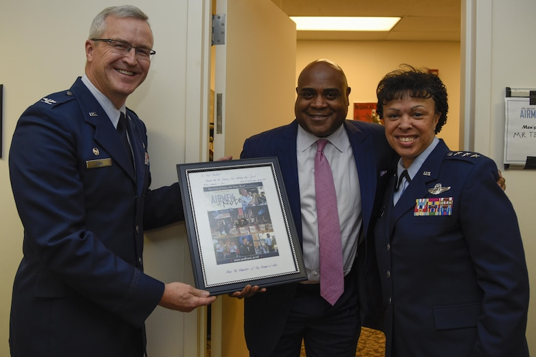 "Col. Larry Lang, left, Air Force Band commander and conductor, and Lt. Gen. Stayce Harris, right, Air Force assistant vice chief of staff, gives Terell Stanfford, center, Jazz Heritage Series iconic jazz artist, a token of appreciation in Alexandria, Va., Nov. 11, 2016. Stanfford was one of the three artists to perform in the Jazz Heritage Series. The Airmen of Note first established the series in 1990 and every year the concert features the ""Note"" with legendary jazz icons. (U.S. Air Force photo by Airman 1st Class Valentina Lopez)"