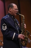 Master Sgt. Andy Axelrad, Air Force Band saxophone player, performs a solo piece in the Jazz Heritage Series at the Rachel M. Schlesinger Concert Hall in Alexandria, Va., Nov. 11, 2016. This is one of Axelrad's last performances before he retires form 24 years of service. The Air Force Band established the Jazz Heritage Series in 1990 which features the Airmen of Note in concert with legendary jazz artists. (U.S. Air Force photo by Airman 1st Class Valentina Lopez)