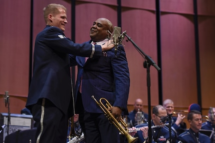 Tech. Sgt. Luke Brandon, Left, Air Force Band trumpeter, and Terell Stanfford, right, jazz trumpeter, embrace in a hug after a duet performance in the Jazz Heritage Series at the Rachel M. Schlesinger Concert Hall in Alexandria, Va., Nov. 11, 2016. Before the Air Force Band, Brandon was a student of Stanfford's teachings at Temple University. In 1990, the band established the Airmen of Note Jazz Heritage Series that features a legendary jazz artist in concert with the band. (U.S. Air Force photo by Airman 1st Class Valentina Lopez)