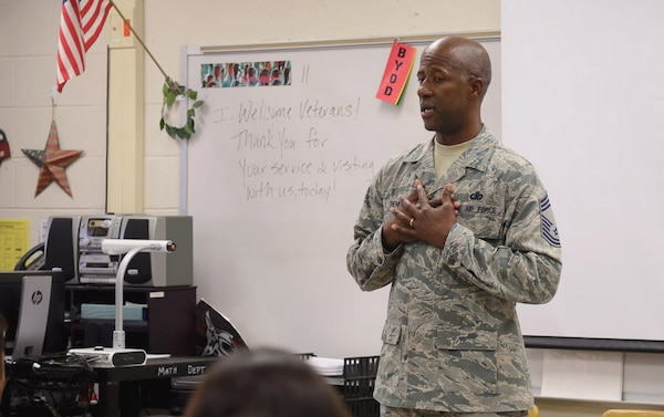 Chief Master Sgt. Marcus Penn, Air Education and Training Command, speaks to students at Stevenson Middle School on Veteran's Day.