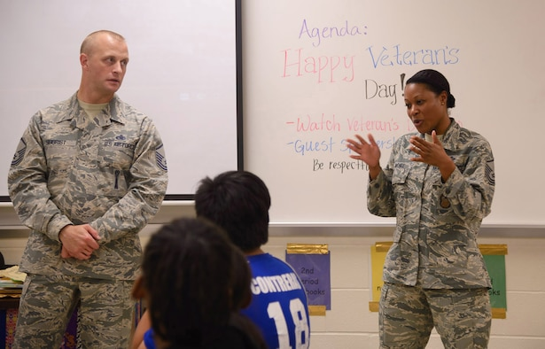 Master Sgts. Carma McCall, 25th Air Force Inspector General's office, and Justin Seigrist, Air Education and Training Command, speak to students at Stevenson Middle School on Veteran's Day. Photo by: Lori A. Bultman