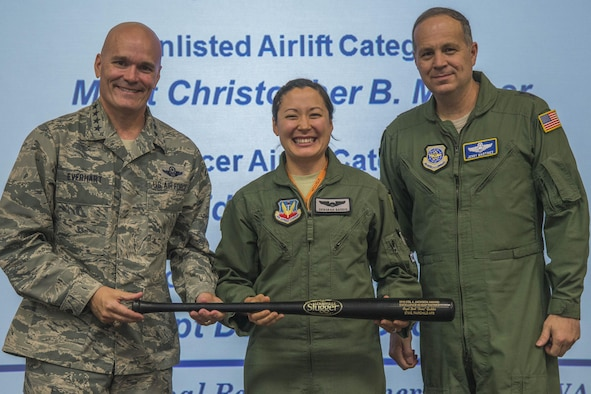 Capt. Deborah Gaddis, 509th Weapons Squadron training flight commander and Weapons Instructor Course instructor, accepts the 2016 Col. Joe Jackson Award for Excellence in Mobility Tactics from Gen. Carlton Everhart, Air Mobility Command commander, and Lt. Gen. Jerry P. Martinez, United States Forces Japan commander and previous AMC director of operations, Sept. 15, 2016, at Scott Air Force Base, Illinois. This annual award represents the very best in the significant achievement in mobility tactics, application of innovative weapons and tactics employment, and the instruction and evaluation of tactics which significantly contributed to increased readiness.