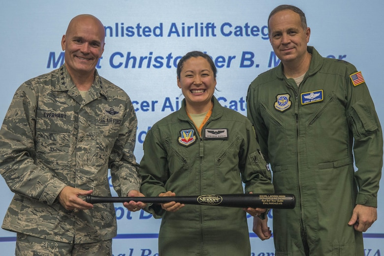 Capt. Deborah Gaddis, 509th Weapons Squadron training flight commander and Weapons Instructor Course instructor, accepts the 2016 Col. Joe Jackson Award for Excellence in Mobility Tactics from Gen. Carlton Everhart, Air Mobility Command commander, and Lt. Gen. Jerry P. Martinez, United States Forces Japan commander and previous AMC director of operations, Sept. 15, 2016, at Scott Air Force Base, Illinois. This annual award represents the very best in the significant achievement in mobility tactics, application of innovative weapons and tactics employment, and the instruction and evaluation of tactics which significantly contributed to increased readiness. (Courtesy Photo)