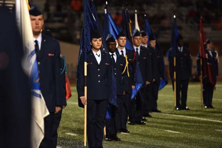 Goodfellow volunteers hold state flags during half-time of the Angelo State University Military Appreciation football game at the San Angelo Stadium, Texas, Nov. 12, 2016. The volunteers came from multiple training squadrons on Goodfellow Air Force Base. (U.S. Air Force photo by Airman 1st Class Caelynn Ferguson/Released)