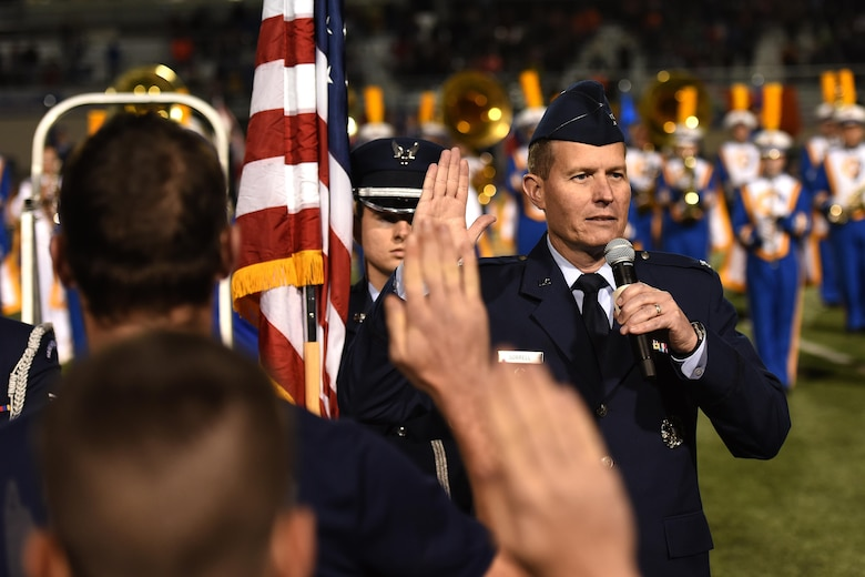 U.S. Air Force Col. Jeffrey Sorrell, 17th Training Wing Vice Commander, swears-in delayed enlistment program members during the Angelo State University Military Appreciation football game at the San Angelo Stadium, Texas, Nov. 12, 2016. The members included enlistees to the U.S. Air Force and the U.S. Navy. (U.S. Air Force photo by Airman 1st Class Caelynn Ferguson/Released)