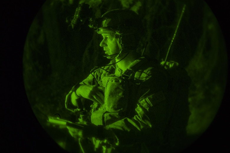 Maj. Michael Hayek, 7th Air Support Operations Squadron director of operations, communicates with an aircraft flying near his location during a surge exercise, Nov. 8, 2016, at Homerville, Ga. During the surge, Moody integrated with various services and units in six locations in the Southeast region. (U.S. Air Force photo by Airman 1st Class Daniel Snider)