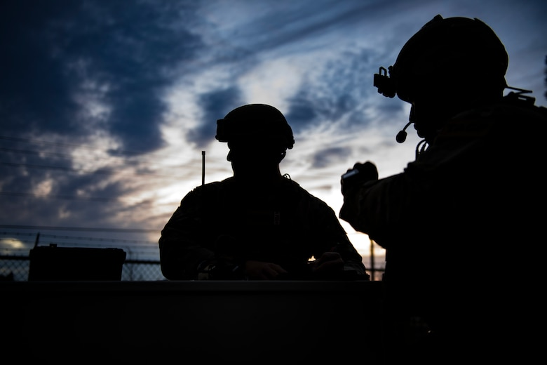 Staff Sgt. Jeffrey Blevins, left, and Senior Airman Parris Holmes, both 7th Air Support Operations Squadron joint terminal attack controllers, await the arrival of aircraft to their location, Nov. 8,2016, at Homerville, Ga. The 7th ASOS was among several Air Force units nationwide assigned to the 93d Air Ground Operations Wing to assist the 23d Fighter Groups' A-10C Thunderbolt II close-air support flying mission. (U.S. Air Force photo by Airman 1st Class Daniel Snider)