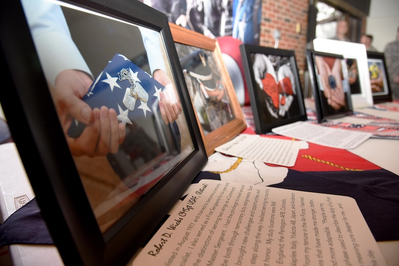 Images from the Hands Display sit on a table at the base theater, on Goodfellow Air Force Base, Texas, Nov. 10, 2016. The images represent both active duty and retired military members' stories. The Hands Display is an on-going project at Goodfellow to increase awareness of service members' stories. (U.S. Air Force photo by Senior Airman Joshua Edwards/Released)