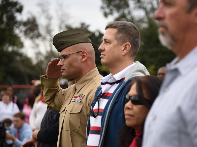 U.S. Marine Gunnery Sgt. Robert Abbott III, Keesler Marine Detachment general calibration aviation mechanic school senior NCO in charge, renders a salute as the U.S. flag is posted during a Jeff Davis Elementary School Veterans Day Celebration Nov. 11, 2016, in Biloxi, Miss. During the event, students delivered the Pledge of Allegiance and sang several patriotic songs. Keesler Air Force Base leadership, Honor Guard Airmen and personnel attended the event. (U.S. Air Force photo by Kemberly Groue/Released)