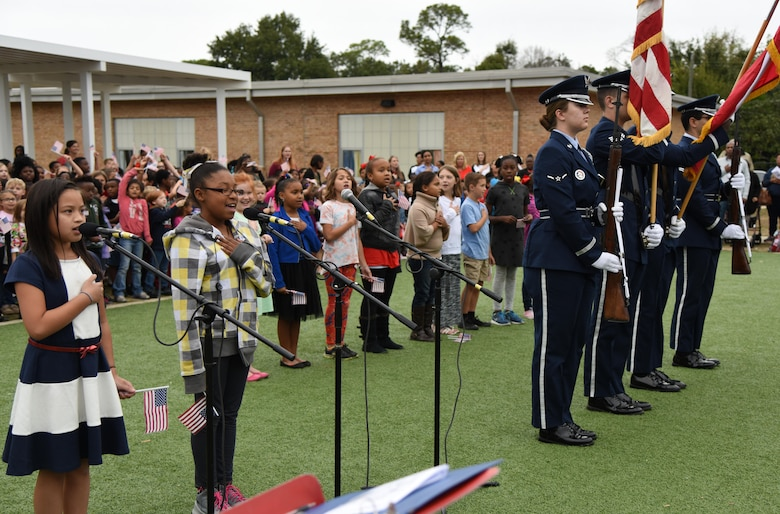 Students at Jeff Davis Elementary School recite the Pledge of Allegiance during a Veterans Day Celebration as the Keesler Honor Guard post the colors Nov. 11, 2016, in Biloxi, Miss. During the event, students delivered the Pledge of Allegiance and sang several patriotic songs. Keesler Air Force Base leadership and personnel attended the event. (U.S. Air Force photo by Kemberly Groue/Released)