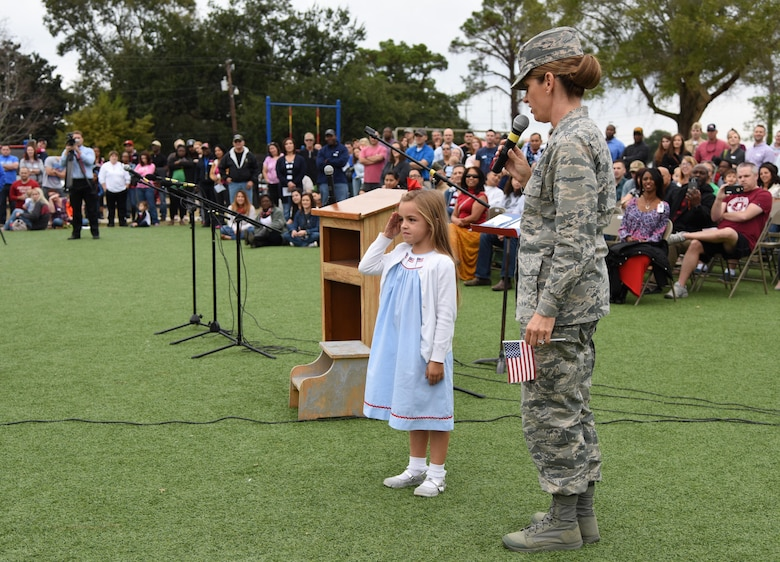 Col. Michele Edmondson, 81st Training Wing commander, introduces her daughter, Jacqueline McGowan, as she demonstrates how to render a salute during a Jeff Davis Elementary School Veterans Day Celebration Nov. 11, 2016, in Biloxi, Miss. During the event, students delivered the Pledge of Allegiance and sang several patriotic songs. The Keesler Honor Guard and other service members also participated in the event. (U.S. Air Force photo by Kemberly Groue/Released)