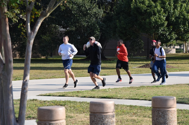 Members of the 81st Security Forces Squadron team run toward their next clue during the Dragon Week Dragon Hunt Nov. 14, 2016, on Keesler Air Force Base, Miss. The scavenger hunt, consisting of six teams, kicked-off a week filled with resiliency and teambuilding events. (U.S. Air Force photo by Kemberly Groue/Released)