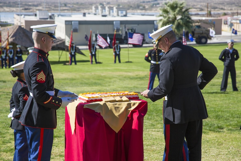 Brig. Gen. William F. Mullen III, Combat Center Commanding General, cuts the Marine Corps Birthday Cake during the Marine Corps Birthday Uniform Pageant at Lance Cpl. Torrey L. Gray Field aboard the Marine Corps Air Ground Combat Center, Twentynine Palms, Calif., Nov. 10, 2016. The pageant celebrates 241 years of Marine Corps history and traditions. (Official Marine Corps photo by Lance Cpl. Anabel Abreu-Rodriguez/Released)