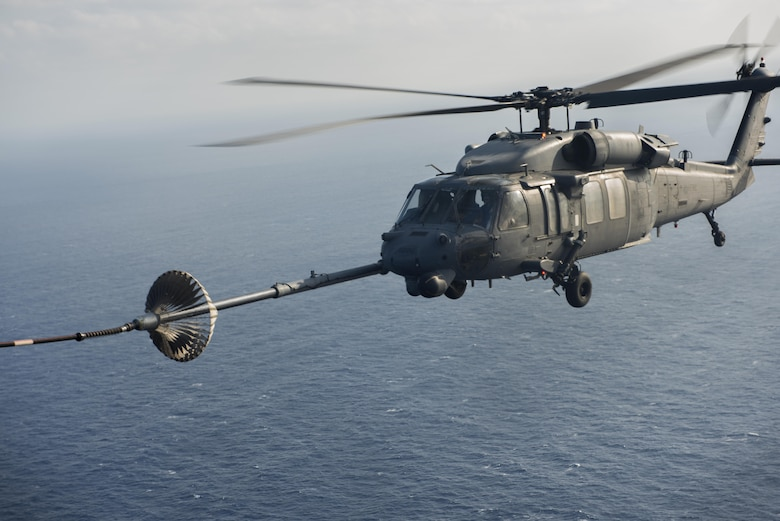 An MC-130H Combat Talon II from the 1st Special Operations Squadron refuels an HH-60 Pave Hawk from the 943rd Rescue Group during Exercise Keen Sword 17 Nov. 7, 2016, near Okinawa, Japan. The 353rd Special Operations Group supported Keen Sword 17 by providing a refueling point for U.S. and Japan Air Self-Defense Force HH-60 Pave Hawks. (U.S. Air Force photo by Airman 1st Class Corey M. Pettis)