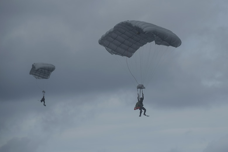 Japan Air Self-Defense Force pararescuemen parachute into the ocean during Exercise Keen Sword 17 Nov. 10, 2016, at Kadena Air Base, Japan. JASDF and 31st Rescue Squadron Pararescuemen conducted a mass casualty exercise, practicing rescuing survivors of an aircraft crash in open ocean. (U.S. Air Force photo by Airman 1st Class Corey M. Pettis)