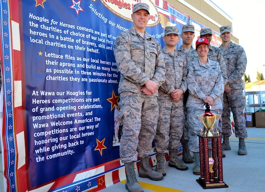 An Air National Guard team from the 111th Attack Wing at Horsham Air Guard Station, Pa., stands with the first-place trophy they won at a hoagie-building competition for the Liberty USO in an event hosted by Wawa Inc., in Cheltenham, Pa., Nov. 10, 2016. Wawa's USO-supported hoagie building competitions have become a 111th ATKW morale and charitable staple for the past few years. (U.S. Air National Guard photo by Tech. Sgt. Andria Allmond)