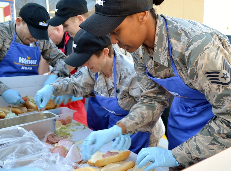 From right to left, Staff Sgt. Charlissa Adams, Master Sgt. Danielle Heidrick, Senior Airman Igor Karlov and Staff Sgt. Heikell Perez, all from the 111th Attack Wing at Horsham Air Guard Station, Pa., furiously assemble hoagies for the Liberty USO in an event hosted by Wawa Inc., in Cheltenham, Pa., Nov. 10, 2016. The Air Guard team raised $1,500 for the USO chapter that supports Pennsylvania and southern New Jersey. (U.S. Air National Guard photo by Tech. Sgt. Andria Allmond)