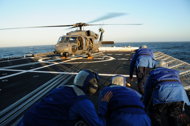 California Air National Guard members assigned to the 129th Rescue Squadron conduct aircraft deck landing qualifications with the United States Coast Guard, approximately 25 nautical miles off the coast of Northern California, June 20, 2012. This is the first landing of an Air Force HH-60G Pave Hawk on the National Security Coast Guard Cutter, USCG Bertholf. (Air National Guard photo by Staff Sgt. Kim E. Ramirez/released)